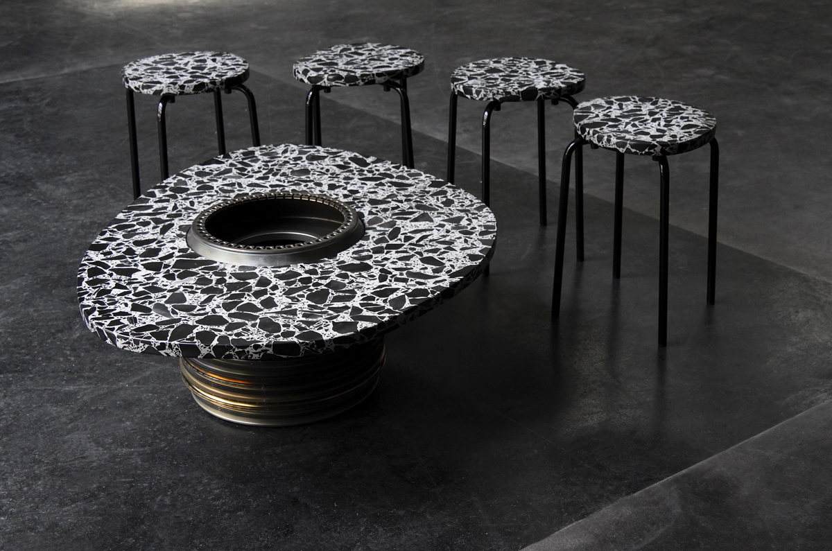 Coveringsetc creates re purposed furniture from lufthansa for Engine parts furniture